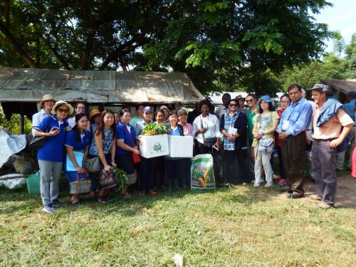 Members of the Thongmang organic growers group being presented with seeds and soil improvers at the end of a visit by members of the CDAIS team and representatives of the TAP and EU